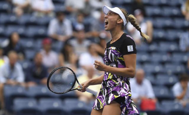 Elise Mertens, of Belgium, reacts after winning a point against Kristie Ahn, of the United States, during the fourth round of the US Open tennis championships Monday, Sept. 2, 2019, in New York. (AP Photo/Sarah Stier)