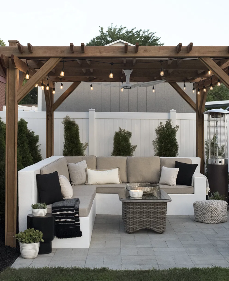"<p>Placing seating along the edge of your deck is a surefire way to make it feel less cluttered. The options are endless from incorporating simple bench seating to adding a corner couch, as shown in this space by blogger <a href=""https://roomfortuesday.com/save-or-splurge-backyard/"" rel=""nofollow noopener"" target=""_blank"" data-ylk=""slk:Room for Tuesday"" class=""link rapid-noclick-resp"">Room for Tuesday</a>.</p>"