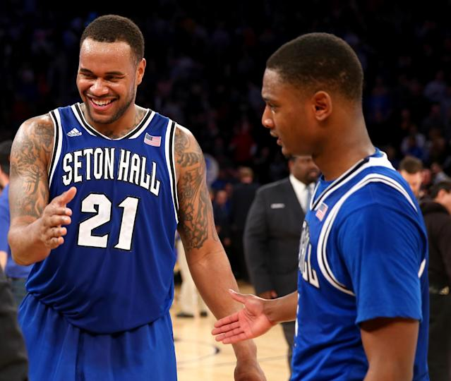 NEW YORK, NY - MARCH 13: Gene Teague #21 of the Seton Hall Pirates celebrates the win with Sterling Gibbs #4 after the win over the Villanova Wildcats during the quarterfinals of the Big East Basketball Tournament at Madison Square Garden on March 13, 2014 in New York City.Seton Hall Pirates defeated the Villanova Wildcats 65-63. (Photo by Elsa/Getty Images)
