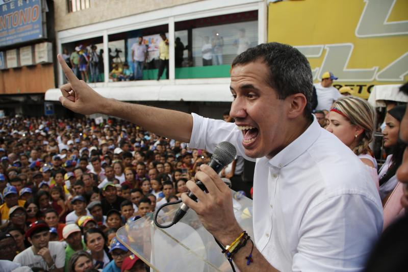 Venezuela's opposition leader and self-proclaimed interim president Juan Guaidó speaks to supporters at a rally in Carora, Venezuela, Saturday, May 25, 2019. Representatives of the Venezuelan government and opposition have returned to Norway for a mediation effort aimed at resolving the political crisis in the South American country, the Norwegian government said Saturday. (AP Photo/Leonardo Fernandez)