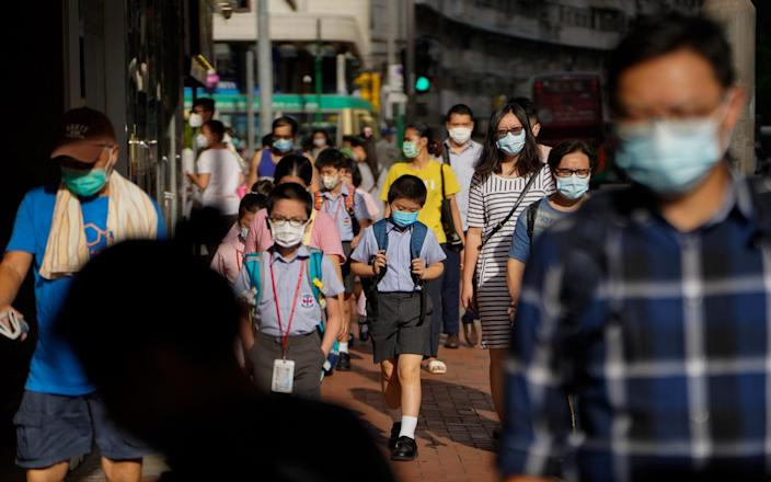 Hong Kong is closing its schools again, as a surge in coronavirus cases within the community after a long stretch without infections - Bloomberg