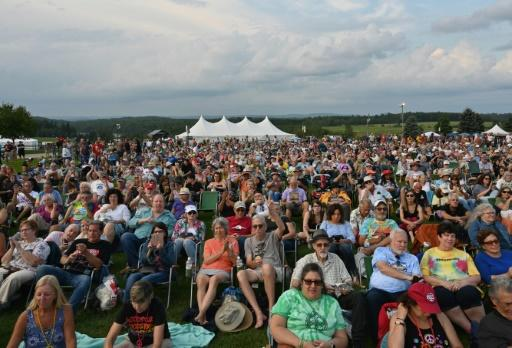 The crowds at the 50th anniversary of Woodstock watched the performance in the comfort of lawn chairs this time around
