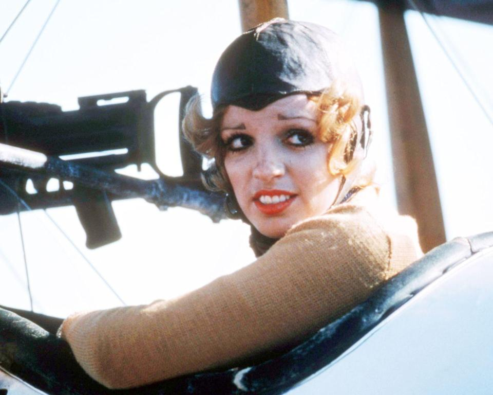 <p>Liza Minnelli helms the cockpit for a publicity shoot in 1975.</p>
