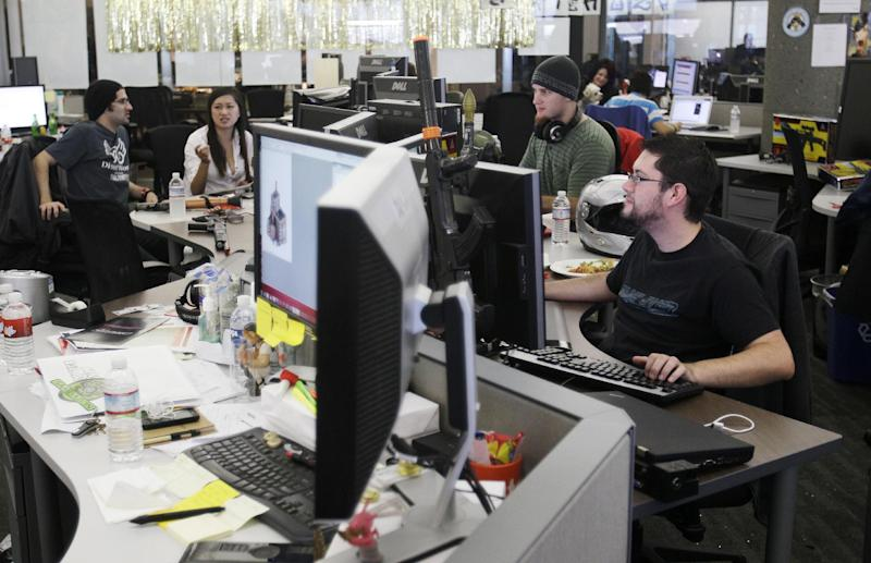 FILE-In this Tuesday, Oct. 11, 2011, file photo, Zynga employees work in the Mafia Wars 2 studio after a Zynga event, in San Francisco. Silicon Valley, it turns out, doesn't revolve around the stock prices of Facebook and its playful sidekick, Zynga. Instead, the optimism in Silicon Valley can be seen in a variety of ways in this area that covers roughly 40 miles from San Jose to San Francisco. (AP Photo/Jeff Chiu)