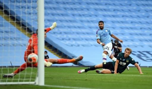 Riyah Mahrez (centre) scores his first goal in Manchester City's thrashing of Burnley