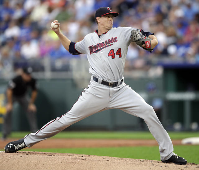 Minnesota Twins starting pitcher Kyle Gibson delivers to a Kansas City Royals batter during the first inning of a baseball game at Kauffman Stadium in Kansas City, Mo., Friday, July 20, 2018. (AP Photo/Orlin Wagner)