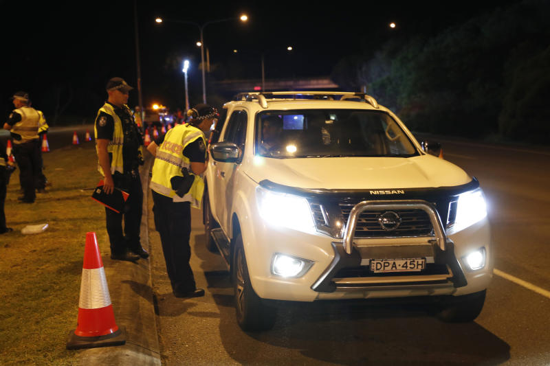 A vehicle is stopped at a checkpoint.