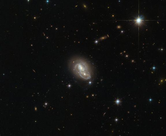 A full view of the unusual galaxy IRAS 06076-2139 seen by the Hubble Space Telescope.