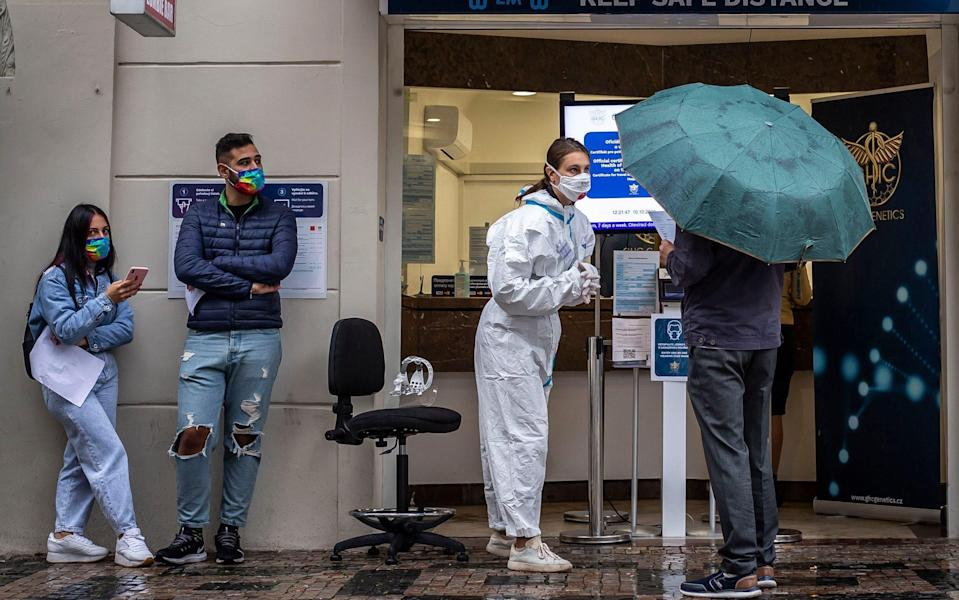 People wait to get tested for COVID-19 at a testing station on October 10, 2020 in Prague - Gabriel Kuchta/ Getty Images Europe