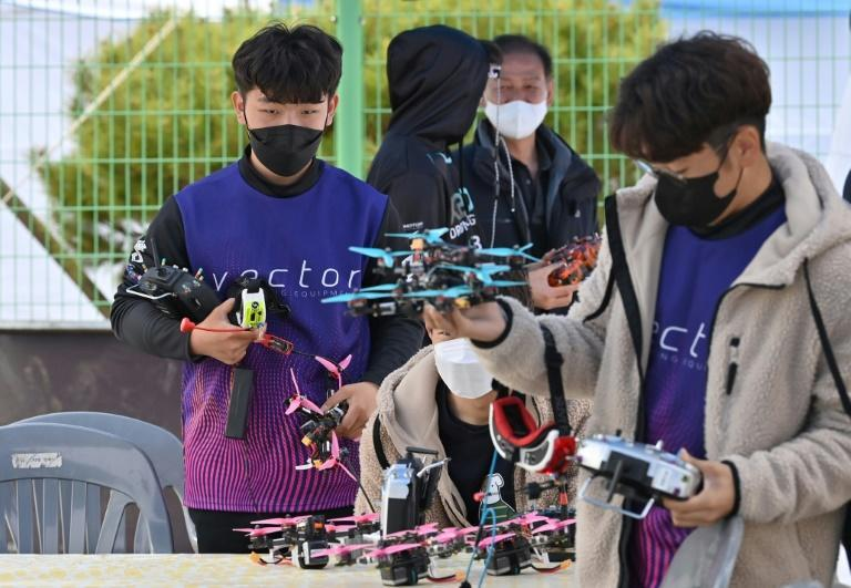 Racing drones are custom-built by competitors and their teams