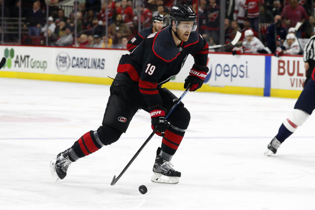 Carolina Hurricanes' Dougie Hamilton (19) brings the puck up the ice on a breakaway against the Washington Capitals during the second period of an NHL hockey game in Raleigh, N.C., Friday, Jan. 3, 2020. (AP Photo/Karl B DeBlaker)