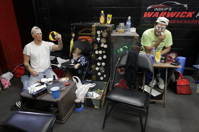 """<p>Ringling Bros. boss clown Sandor Eke, left, and Ivan Vargas put on makeup as Eke's 2-year-old son Michael watches videos on a phone before a performance, Friday, May 5, 2017, in Providence, R.I. """"The Greatest Show on Earth"""" is about to put on its last show on earth. For the performers who travel with the Ringling Bros. and Barnum & Bailey Circus, its demise means the end of a unique way of life for hundreds of performers and crew members. (Photo: Julie Jacobson/AP) </p>"""