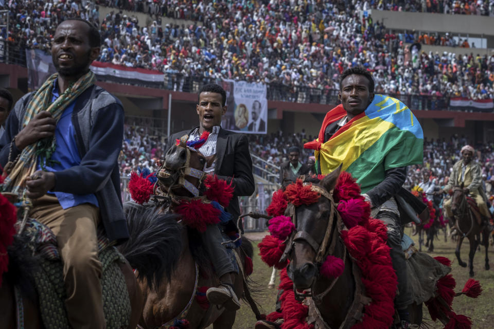 Horsemen perform on the field as supporters fill the stands at the final campaign rally of Ethiopia's Prime Minister Abiy Ahmed in the town of Jimma in the southwestern Oromia Region of Ethiopia Wednesday, June 16, 2021. The country is due to vote in a general election on Monday, June, 21, 2021. (AP Photo/Mulugeta Ayene)