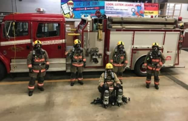 Firefighters with the South Bruce Fire Rescue service pose in new gear purchased by the NWMO, which is spending millions in the community on everything from playgrounds to finding rural doctors with its 'goodwill' fund.