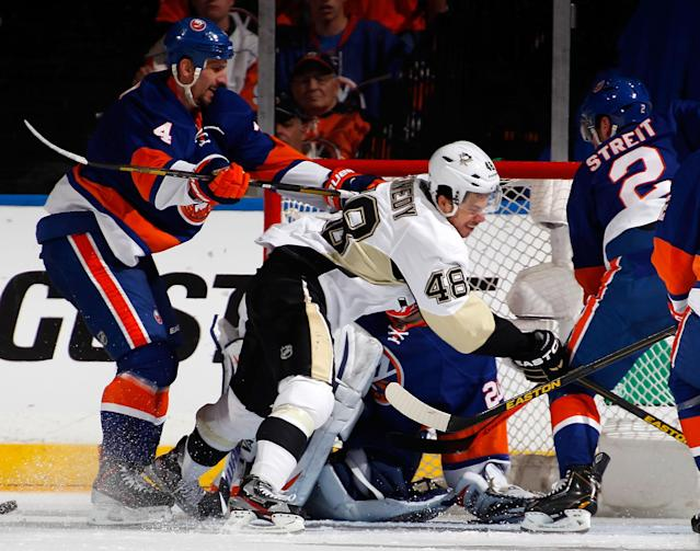 UNIONDALE, NY - MAY 11: Radek Martinek #4 of the New York Islanders checks Tyler Kennedy #48 of the Pittsburgh Penguins in front of the goal and received a two minute cross checking penalty in the second period in Game Six of the Eastern Conference Quarterfinals during the 2013 NHL Stanley Cup Playoffs at Nassau Veterans Memorial Coliseum on May 11, 2013 in Uniondale, New York. (Photo by Paul Bereswill/Getty Images)