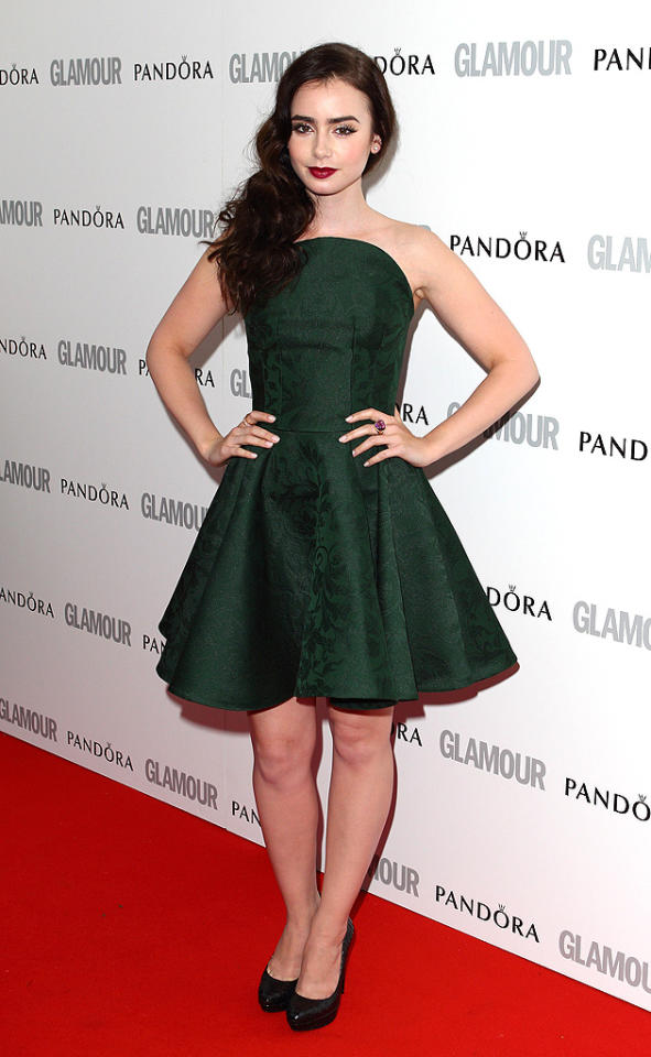"Lily Collins stepped out in a short and flirty green Alexander McQueen frock to pick up the Breakthrough of the Year award. The ""Mirror Mirror"" star has maintained the dark 'do she first debuted last September, but you can expect more hair hue changes in the future. ""I had to dye my hair bright red for 'Priest,'"" the 23-year-old actress recently said. ""I'd never changed my color before, but I totally loved it because it helped me become my character. If a role calls for me to go blond, I'm up for it!"""
