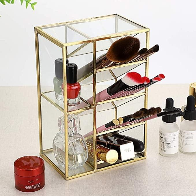 <p>Display your brushes, lip products, eyeliners, and mascaras with the <span>Hipiwe Vintage Gold Metal Desk Organizer</span> ($19).</p>
