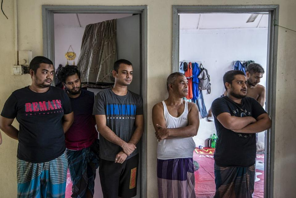 Abas Sordel (third from left) became the sole breadwinner after his father died nine years ago. — Picture by Shafwan Zaidon