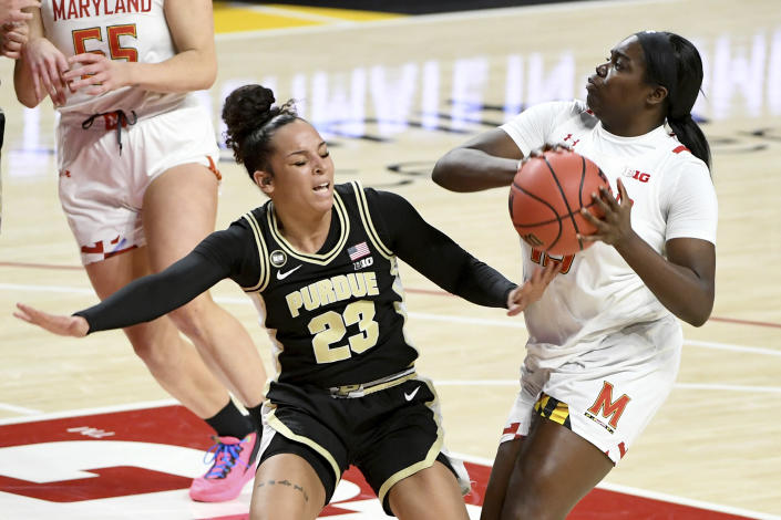 Maryland guard Ashley Owusu (15) looks to shoot in front of Purdue guard Kayana Traylor (23) during the second half of an NCAA college basketball game, Sunday, Jan. 10, 2021, in College Park, Md. (AP Photo/Will Newton)