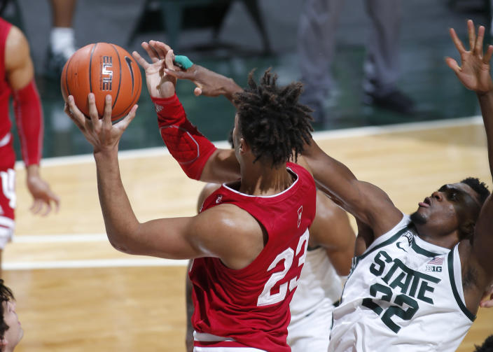 Indiana's Trayce Jackson-Davis, left, and Michigan State's Mady Sissoko vie for a rebound during the first half of an NCAA college basketball game, Tuesday, March 2, 2021, in East Lansing, Mich. (AP Photo/Al Goldis)