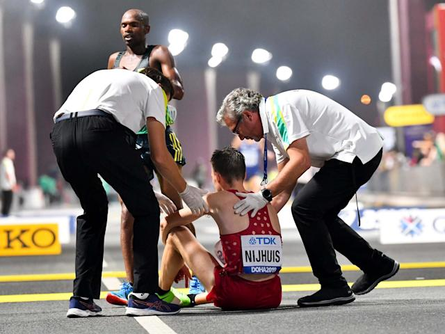 The World Championships marathon in Doha was held at midnight to combat the heat: EPA