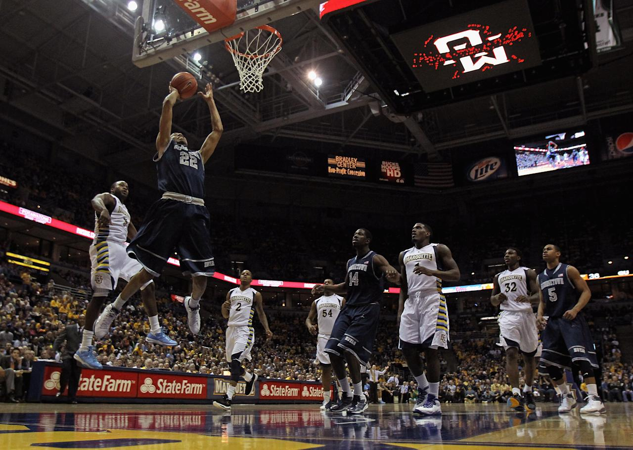 MILWAUKEE, WI - MARCH 03:  Otto Porter #22 of the Georgetown Hoyas puts up a shot past Junior Cadougan #5 of the Marquette Golden Eagles at the Bradley Center on March 3, 2012 in Milwaukee, Wisconsin. Marquette defeated Georgetown 83-69.  (Photo by Jonathan Daniel/Getty Images)