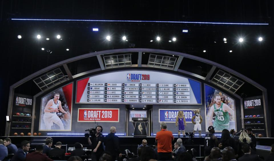 The draft board displays the picks for the first round in the NBA basketball draft Thursday, June 20, 2019, in New York. (AP Photo/Julio Cortez)