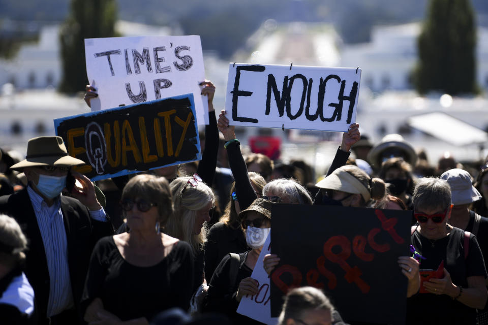 Protesters hold up signs during the Women's March 4 Justice in Canberra.