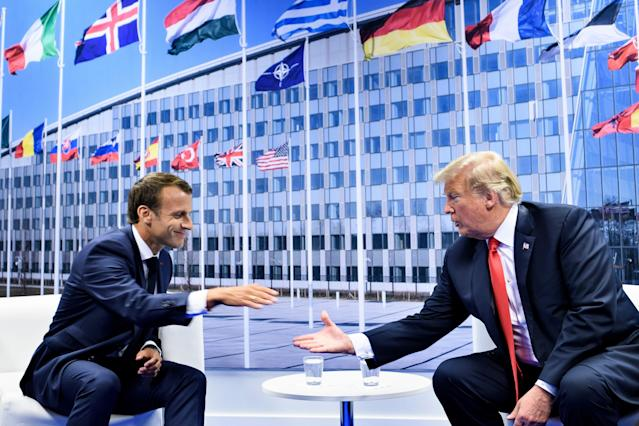 <p>French President Emmanuel Macron and President Trump shake hands before their bilateral meeting on the sidelines of the NATO summit in Brussels on July 11, 2018. (Photo: Brendan Smialowski/ AFP/Getty Images) </p>