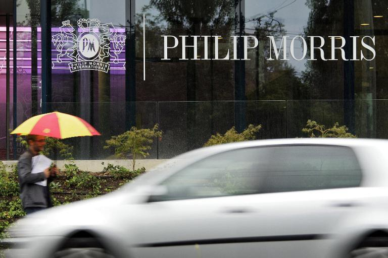 A passerby walks in front of Philip Morris International's headquarters in Lausanne on August 29, 2007