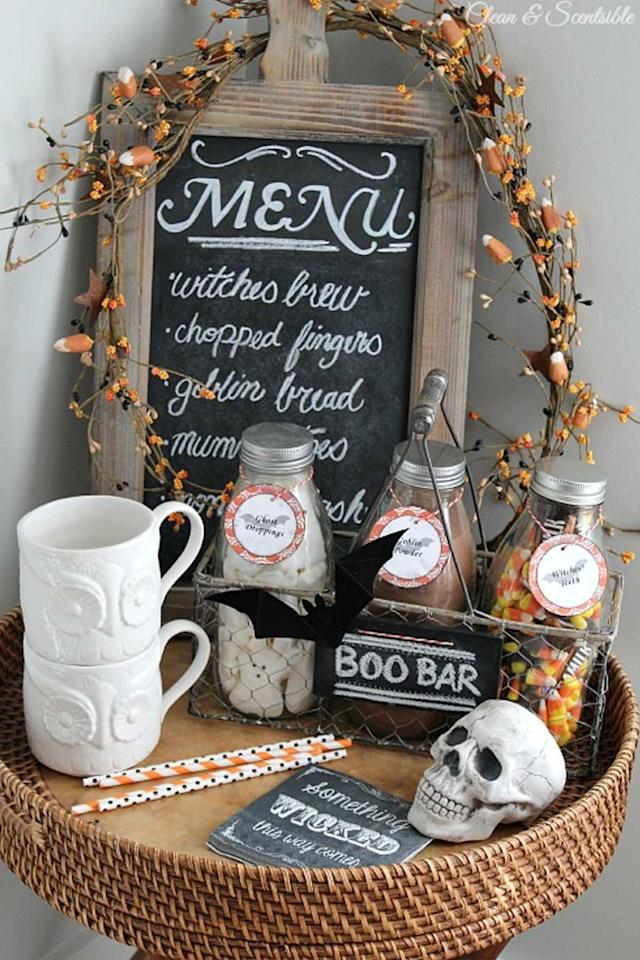 "<p>Warm up on a chilly night with a cup of hot chocolate topped with ghost-shaped marshmallows and candy corn.<span></span></p><p><strong>Get the tutorial at <a rel=""nofollow"" href=""http://www.cleanandscentsible.com/2014/10/halloween-beverage-bar.html"">Clean & Scentsible</a>. </strong><br></p><p><strong>What you'll need: </strong><span><em>Thin wooden plaque ($12; <a rel=""nofollow"" href=""https://www.amazon.com/Walnut-Hollow-Basswood-Circle-8/dp/B000YQIO12?tag=syndication-20"">amazon.com</a>); Chalkboard spray paint ($4; <a rel=""nofollow"" href=""https://www.amazon.com/Rust-Oleum-1913830-Chalkboard-Spray-11-Ounce/dp/B000RMPLJ6?tag=syndication-20"">amazon.com</a>); wire basket ($12; <a rel=""nofollow"" href=""https://www.amazon.com/Spectrum-Diversified-Storage-Basket-Medium/dp/B001AMMNGG/?tag=syndication-20"">amazon.com</a>); Baker's twine ($11; <a rel=""nofollow"" href=""https://www.amazon.com/Bakers-Twine-Yards-Grey-White/dp/B00DKMSR28?tag=syndication-20"">amazon.com</a>); Marshmallow peeps ($14 for pack of 3; <a rel=""nofollow"" href=""https://www.amazon.com/Halloween-Peeps-Spooky-Ghosts-count/dp/B00A8MRNYG?tag=syndication-20"">amazon.com</a>); Hot chocolate powder ($15; <a rel=""nofollow"" href=""https://www.amazon.com/Nestle-Chocolate-Servings-27-7-Ounce-Canisters/dp/B002HFWNAQ?tag=syndication-20"">amazon.com</a>); Candy corn ($8; <a rel=""nofollow"" href=""https://www.amazon.com/Jelly-Belly-Gourmet-Candy-Ounce/dp/B00AYGEFAQ?tag=syndication-20"">amazon.com</a>)</em></span></p>"