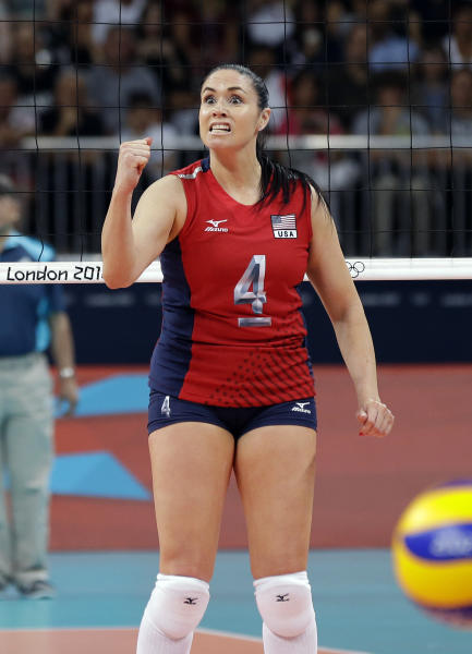 USA's Lindsey Berg (4) reacts after the team scored a point against South Korea during a women's volleyball semifinal match at the 2012 Summer Olympics Thursday, Aug. 9, 2012, in London. (AP Photo/Chris O'Meara)