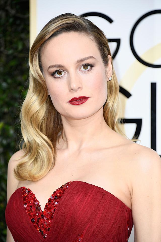 <p>Brie Larson looked striking rocking golden blonde '60s waves and a scarlet rouge lip. (Photo: Getty Images) </p>