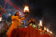 Hindu devotees perform rituals in Ayodhya, India , Saturday, Nov. 9, 2019. India's Supreme Court on Saturday ruled in favor of a Hindu temple on a disputed religious ground and ordered that alternative land be given to Muslims to build a mosque. The dispute over land ownership has been one of the country's most contentious issues. (AP Photo/Rajesh Kumar Singh)
