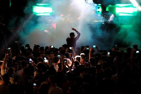 Young people attend electronic music concert with western tunes, at closed Hall in Shaab Stadium, for the first time in Baghdad