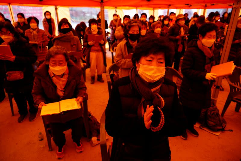 Buddhist believers pray for their children's success in the college entrance examinations amid the coronavirus disease (COVID-19) pandemic, at a Buddhist temple in Seoul