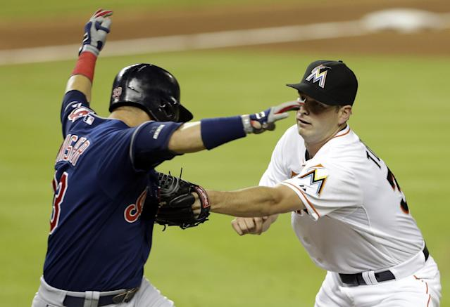 Miami Marlins starting pitcher Jacob Turner, right, tags out Cleveland Indians' Nick Swisher in the fifth inning of an interleague baseball game, Saturday, Aug. 3, 2013, in Miami. (AP Photo/Lynne Sladky)