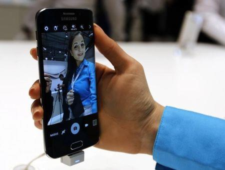 A hostess displays the new Samsung Galaxy S6 smartphone during the Mobile World Congress in Barcelona