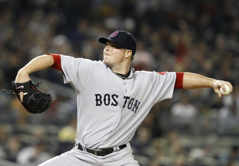 Boston Red Sox starting pitcher Jon Lester (31) delivers in the fourth inning against the New York Yankees in their baseball game at Yankee Stadium Sunday, May 15, 2011 in New York. (AP Photo/Kathy Willens)