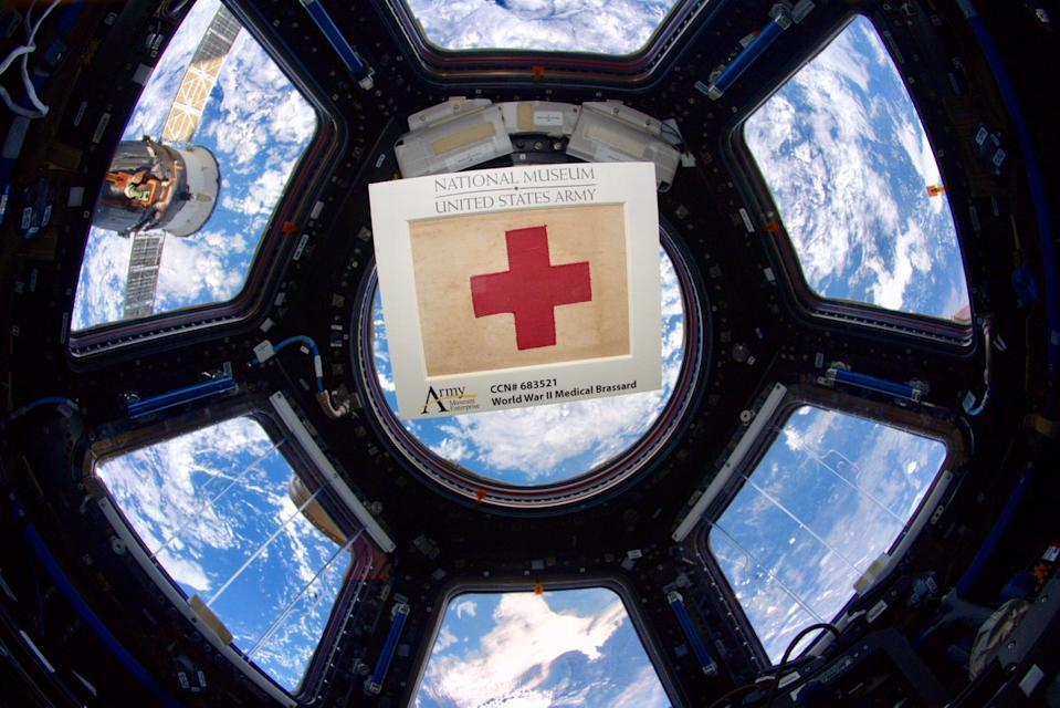 "To honor the frontline medical workers of the COVID-19 pandemic on the 75th anniversary of Victory in Europe Day, which marked the end of World War II in Europe, NASA astronaut Andrew Morgan tweeted this photo of a WWII medical armband floating in the Cupola observatory of the International Space Station.  ""Much like first responders on the frontlines today, 75 years ago combat medics bravely faced grave danger to save fellow #Soldiers on the battlefield,"" Morgan tweeted May 8. ""This WW2 medical armband accompanied me to @space_station and will soon reside @NatlArmyMuseum."" Morgan returned from the space station in April after spending 272 days on board the orbiting lab."