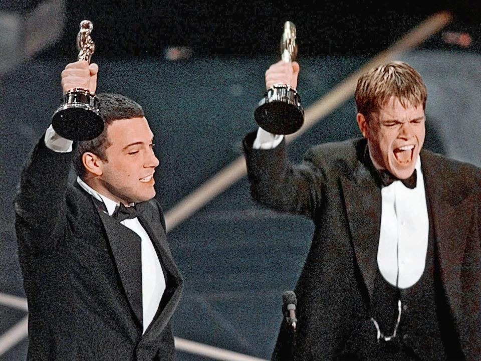 Ben Affleck and Matt Damon (l-r) react to winning Oscar for Best Original Screenplay for