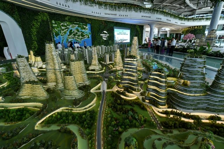Visitors view a scale model of the Forest City development on one of the man-made islands off Malaysia