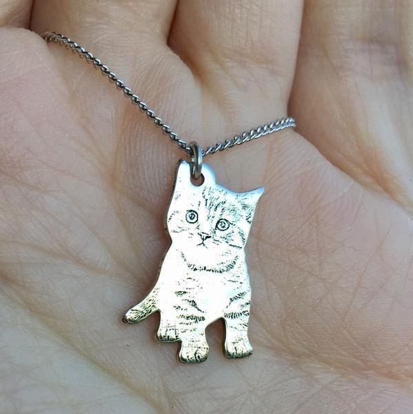 """<p>ilovemypetmorethanyou.com</p><p><strong>$39.99</strong></p><p><a href=""""https://ilovemypetmorethanyou.com/collections/jewelry/products/engraved-silver-pet-photo-necklace"""" rel=""""nofollow noopener"""" target=""""_blank"""" data-ylk=""""slk:Shop Now"""" class=""""link rapid-noclick-resp"""">Shop Now</a></p><p>If you've ever thought, """"Wow, there is no one more obsessed with their pet than my girlfriend,"""" then this is a great purchase. You can get their pet's photo turned into a necklace charm, the brand donates a portion of each sale to an animal rescue, and yes, they will love you forever.</p>"""