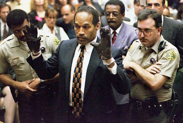 <p>O.J. Simpson holds his hands up to the jury on June 15, 1995, to show the bloody gloves the prosecution says he wore when he murdered Nicole Brown Simpson and Ron Goldman. (Photo: Sam Mircovich/Reuters) </p>