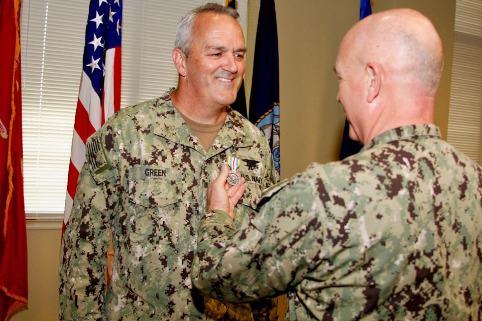 U.S. Southern Command Commander, Adm. Kurt W. Tidd, presents Rear Adm. Collin P. Green, Special Operations Command South's outgoing commander, with a Defense Superior Service Medal for exceptional superior service as SOCSOUTH commander during a ceremony held in Homestead Air Reserve Base, Fla., June 5, 2018. (Photo:: Sgt. 1st Class Alexis R. Ramos/U.S. Military)