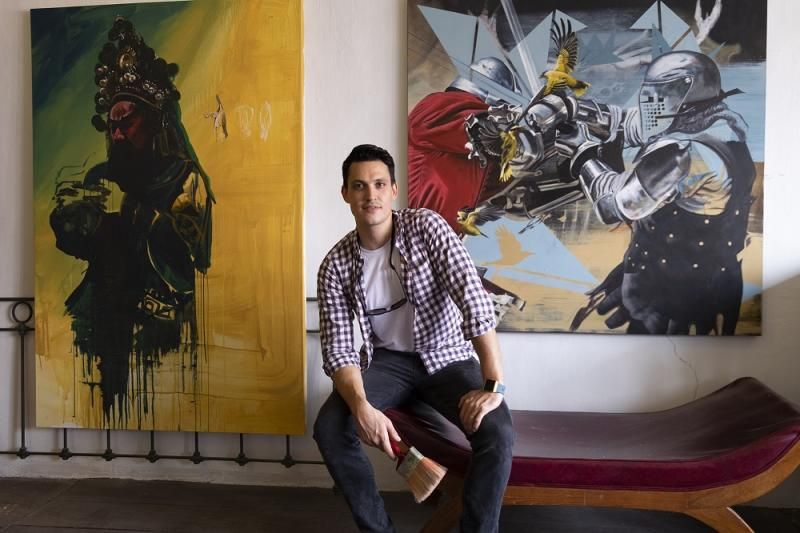 Artist Thomas Powell with his distinctive paintings. — Pictures by Steven Ooi KE