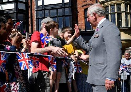 Britain's Prince Charles 'high-fives' a well-wisher during visit to Salisbury in southwest Britain, June 22, 2018. REUTERS/Toby Melville