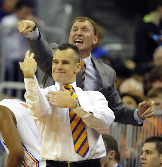 Florida coach Billy Donovan, front, and Assistant coach John Pelphrey, rear, work hard at getting a message on court during the first half of an NCAA college basketball game against Kentucky Saturday, March 8, 2014 in Gainesville, Fla. Florida defeated Kentucky 84-65 to give them and undefeatedf season in the SEC. (AP Photo/Phil Sandlin)