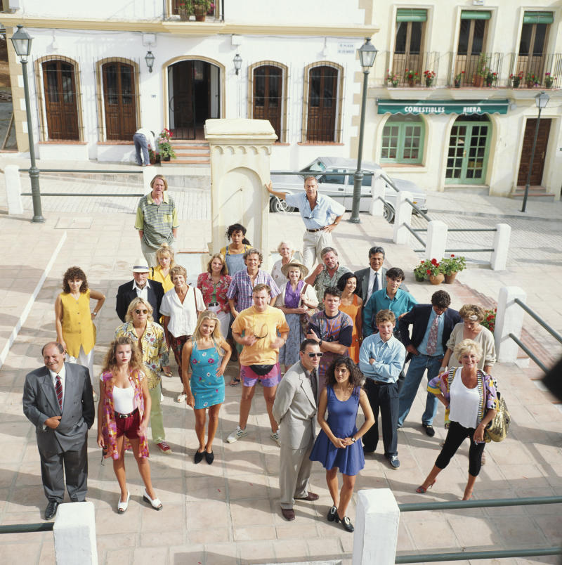 View of the cast of the BBC television soap opera Eldorado pictured together on the specially built set in Spain circa 1992. (Photo by Larry Ellis Collection/Getty Images)