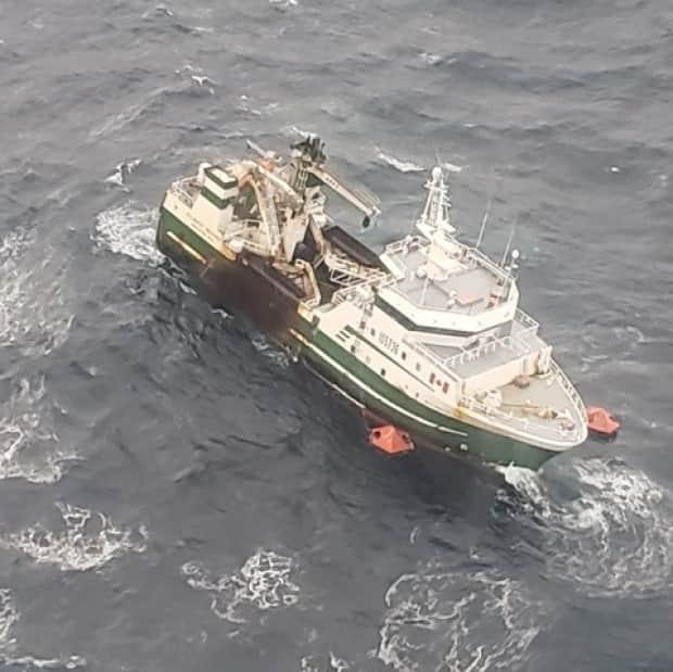 A picture showing the transfer of the final four crew from the Atlantic Destiny, which was in distress off the coast of Nova Scotia, to a Canadian Coast Guard ship Wednesday morning. The ship sunk hours later. (Joint Rescue Co-ordination Centre - image credit)